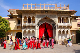 Local school kids walking out of Rajendra Pol in Jaipur City Palace, Rajasthan, India