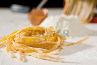 Closeup of tagliatelle pasta and its ingredients