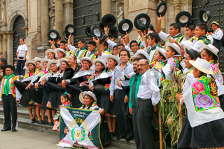 Group of dancers posing during Festival of the Virgin de la Candelaria in Lima, Peru