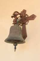 An old bell at the wall of a church.
