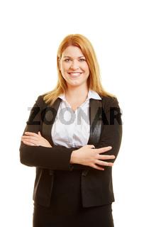 Blonde Geschäftsfrau mit verschränkten Armen