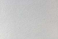Strukturierte gekörnte weiße Wand.