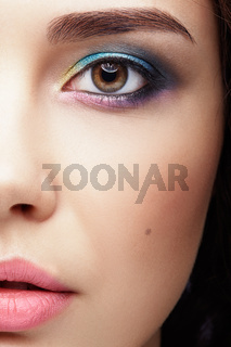 Closeup macro portrait of female face. Human woman half-face  with evening beauty makeup.