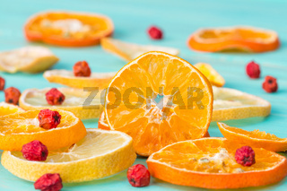Sliced citrus fruits and rowan berry