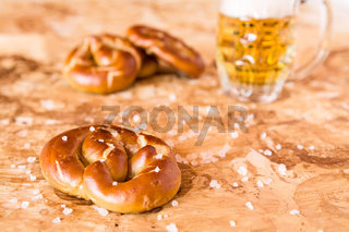 Salty cooked pretzel and lager beer