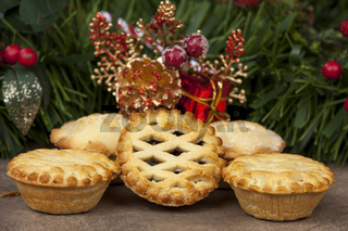 Selection of mince pies with a christmas background