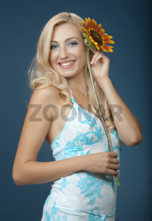 The beautiful girl with a sunflower