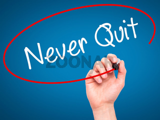 Man Hand writing Never Quit with black marker on visual screen.