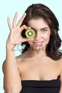 Woman with slice of kiwi