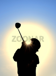 Silhouette of Teen Girl Swinging a Driver