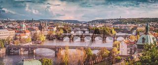 Prague, Czech Republic bridges skyline with historic Charles Bridge and Vltava river. Vintage