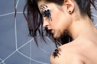 spider girl and spider Brachypelma smithi