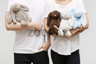 Couple with toy rabbits