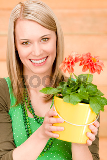 Portrait happy woman hold potted flower spring
