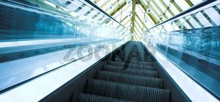 Blue move escalator in modern office centre