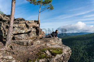 Man seat in a peak in Ural mountains