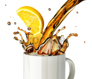 Pouring lemon tea splashing into a glass mug.