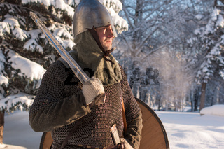 Portrait of a medieval warrior in the winter forest