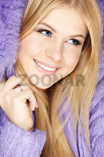 Beautiful blonde muffles up in the violet clothes