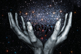 God's hands holding a star galaxy