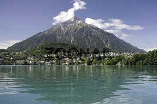 Lake Thun with village Spiez and Mount Niesen, Switzerland