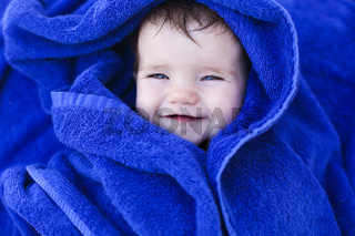 Six month baby wearing towel after bath