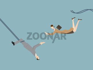 Teamwork Challange Concept. A Businessman Catching a Flying Businesswoman As a Trapeze Artist.