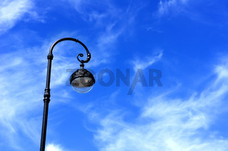 street lamppost against the blue sky