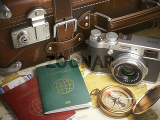 Travel or turism background concept.  Old  suitcase,  passports with boarding pass, vintage camera, campass on the  map.