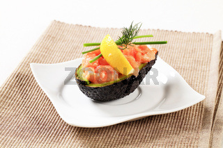 Avocado half stuffed with cured salmon