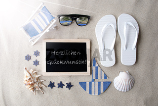 Sunny Blackboard On Sand, Glueckwunsch Means Congratulations