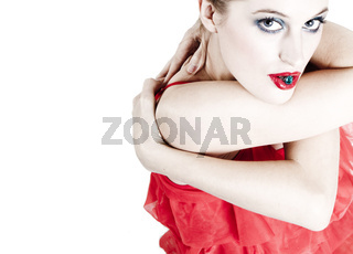 woman in a red dress posing on a white background