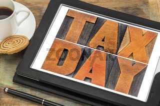 tax day in vintage wood type on tablet