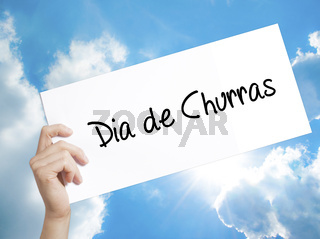 Dia de Churras (Barbecue Day In Portuguese) Sign on white paper. Man Hand Holding Paper with text. Isolated on sky background