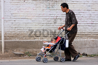 Chinese man and baby