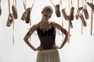 Blonde ballerina and pointe shoes