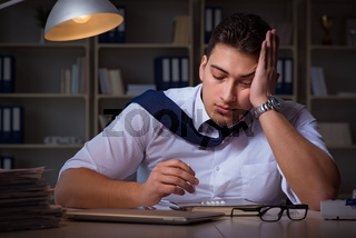 Businessman staying late in office for drugs