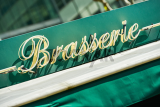 Word brewery ('Brasserie' in french) on an green arbor