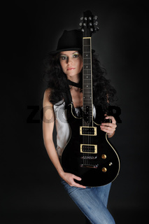 Beautiful long-haired girl with a guitar