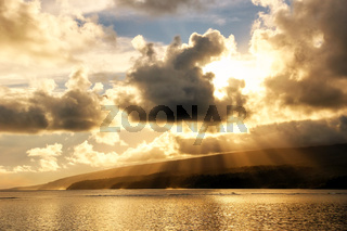 Sunset with rays in Lavena village on Taveuni Island, Fiji