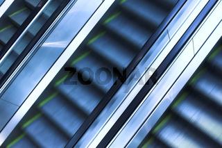 Three mooving escalators