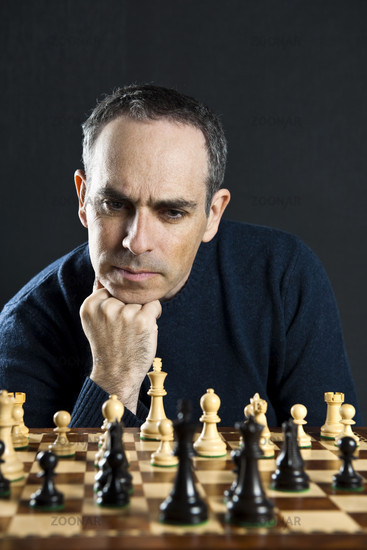 Man at chess board