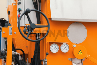 Industrial wheel - manual control panel of tractor machine for road construction