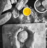 Baker kneading fresh organic bread