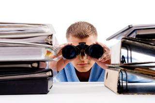 adult professional posing with binocular
