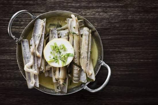 fresh razor shell seafood steamed in garlic herb wine sauce