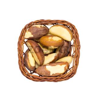 Top view of Brazil Nuts in pretty little basket.