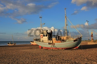 Summer day at Slettestrand, Jammerbugten. Fishing boat on the shore.
