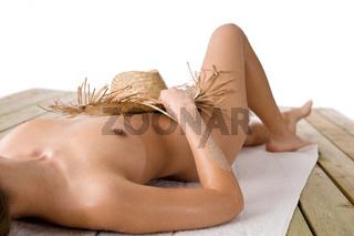 Naked woman sunbathing on beach