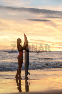 Attractive girl with a surf
